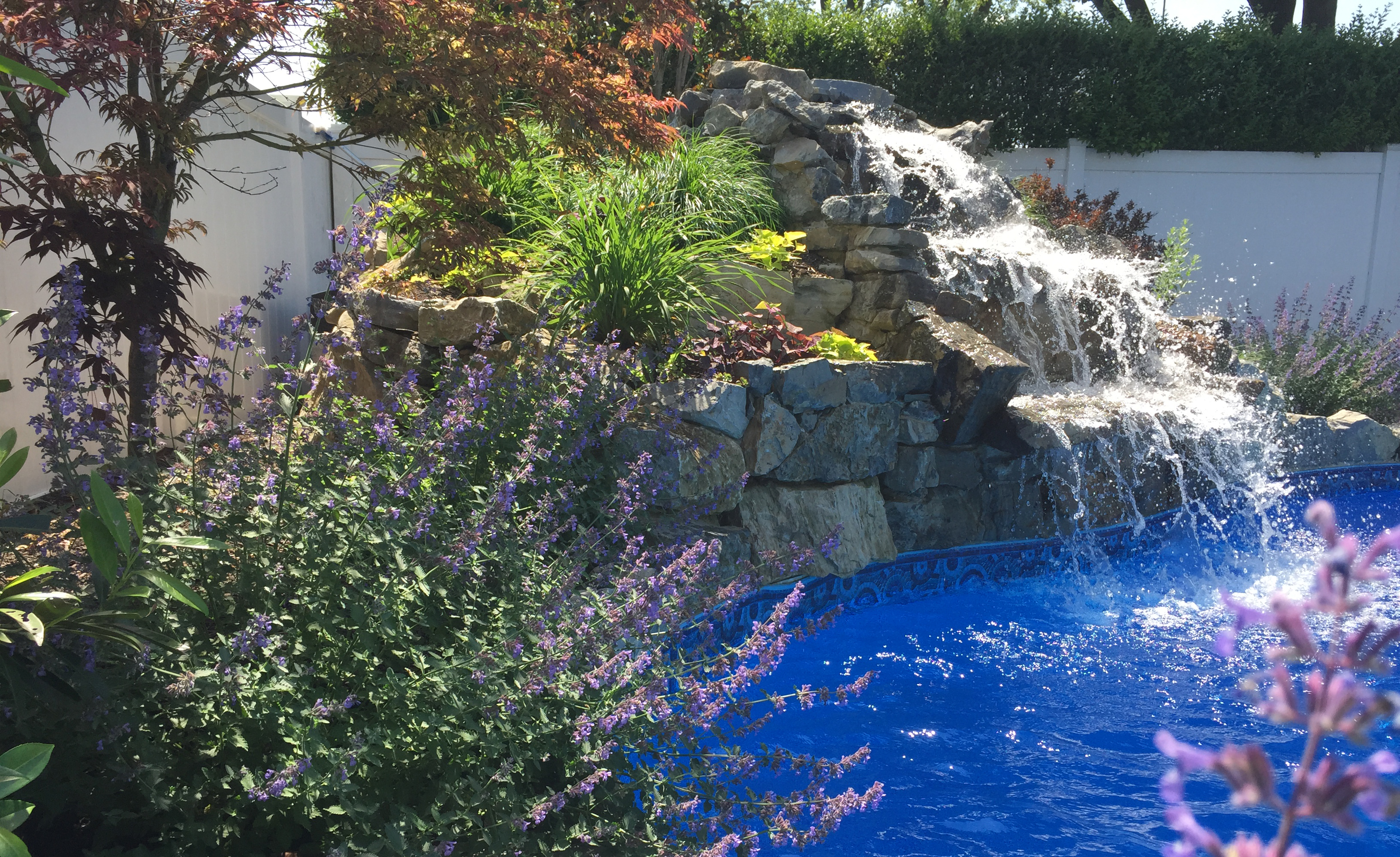 Waterfall construction specialists autumn leaf landscape for Tiered pond waterfall