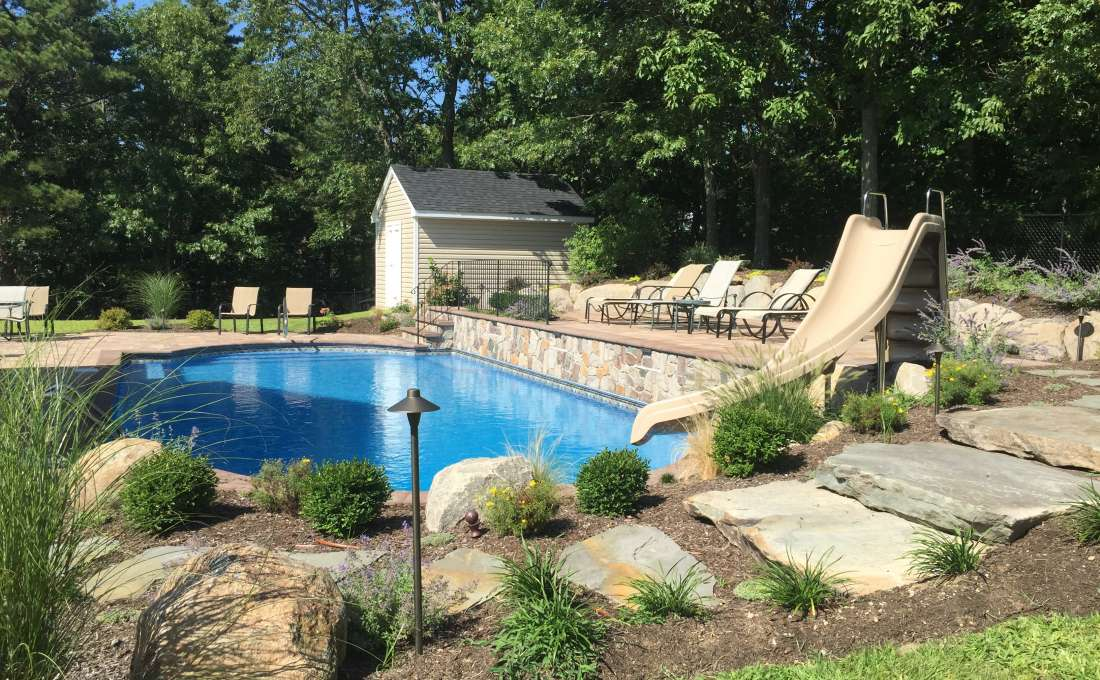 Commack, Long Island Custom Paving Stone Pool Patio.