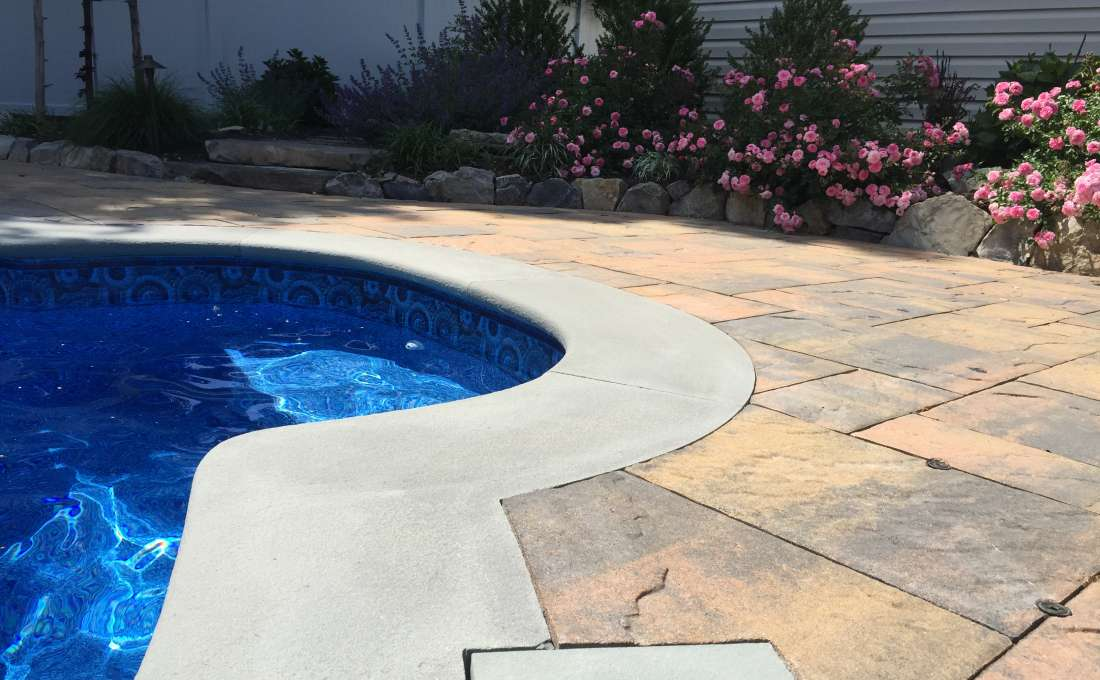 Free Form Pool Design with Waterfall | Autumn Leaf