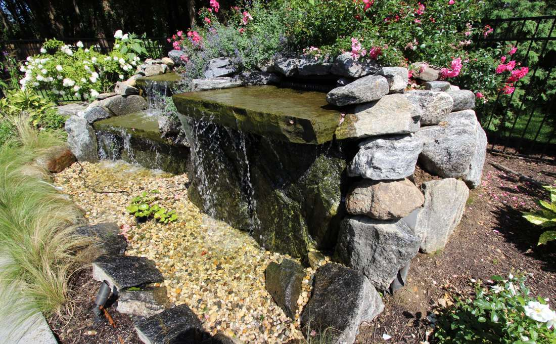 Waterfall construction specialists autumn leaf landscape for Ornamental pond waterfall