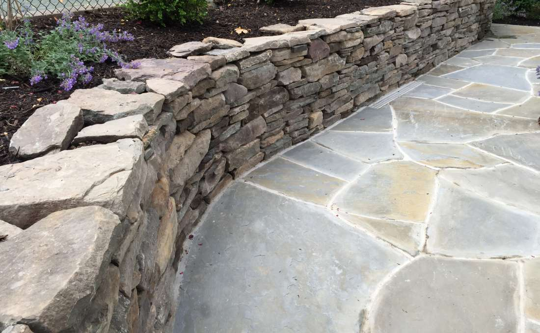 rock wall design. Natural rock walls truly create unique landscapes as two stones are never  the same Autumn Leaf s skilled masons will build your garden wall to last for Retaining Wall Construction Professionals