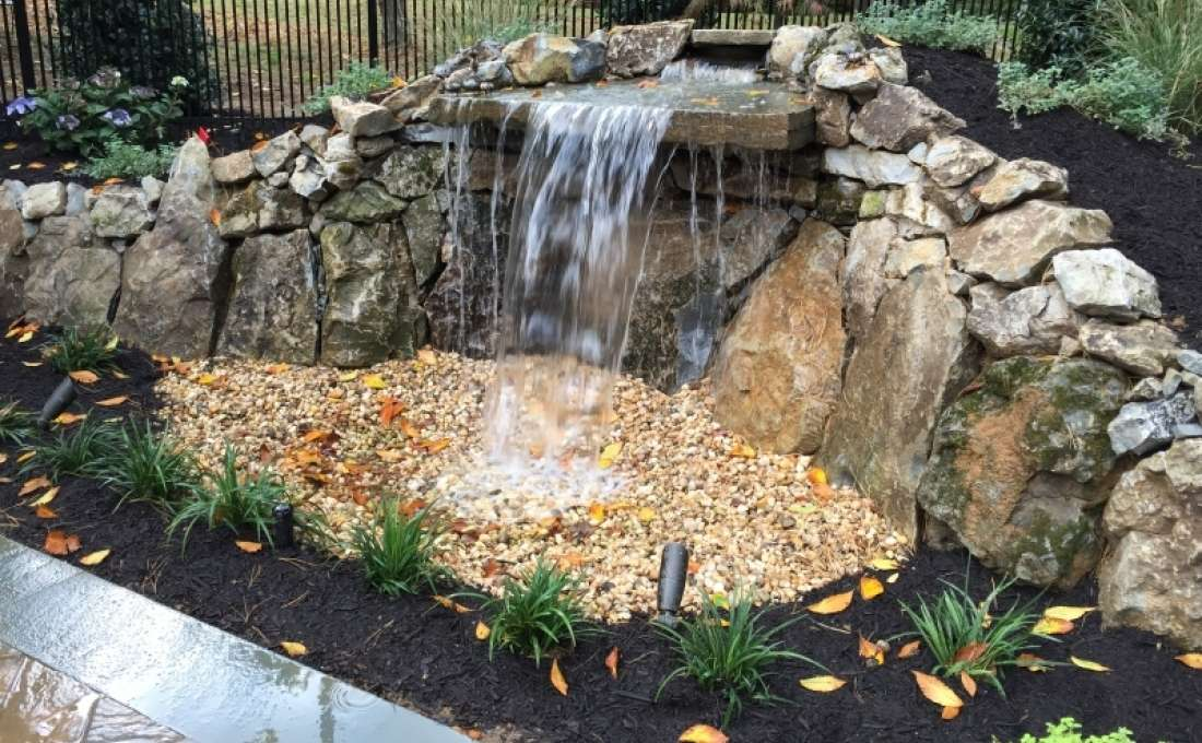 Waterfall construction specialists autumn leaf landscape for Building a pond waterfall