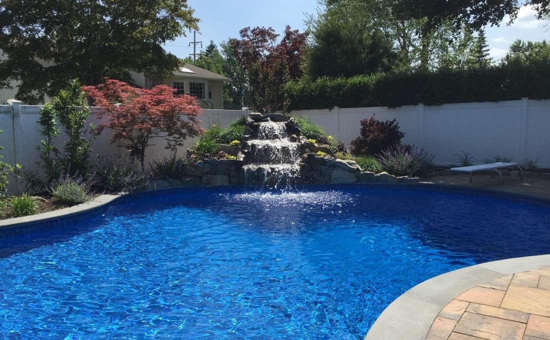 Cutsom swimming pool landscape designs autumn leaf for Pool design long island ny
