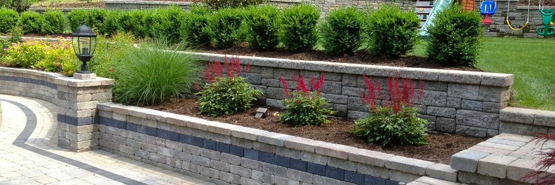 Retaining wall construction professionals autumn leaf for Stone retaining wall design