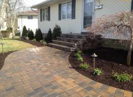 Cambridge paving stone front entry with evergreen and perennial plants