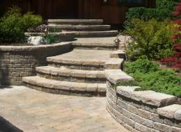 Paving stone front entry design with retaining walls