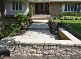 Front Entry paving stone walkway design with inlay and seat wall