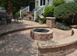 Nicolock fire pit patio with segmental seat wall and light piers