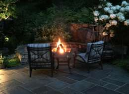 Bluestone patio with fire put and seat wall