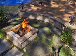 Bluestone fire pit area with seat wall in pool area