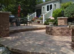 Nicolock paving stone patio with fire pit and dining area