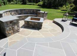 Bluestone patio and fire pit area with natural fieldstone veneer