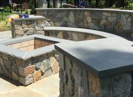Fire pit design with bluestone bench and natural field stone veneer