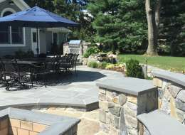 Fire pit area design with bluestone flagstone patio cooking area