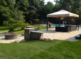 Cambridge paving stone pool patio with fire pit area