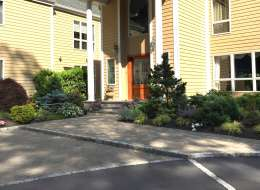 Pavingstone front entry walkway and ornamental plants