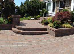 Paving stone driveway and front entry walkway with light pier