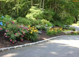 Driveway landscape planting bed with perennial flowers