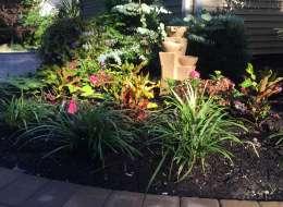 Flowering perennial plants and garden sculpture
