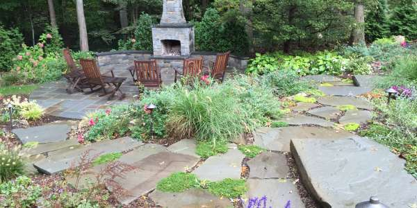Bluestone fireplace patio with perennial plants and dry laid stepping stones